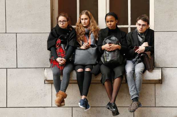 sorbonne-university-students-sitting-on-window-ledge