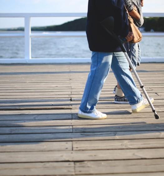woman-walking-jeans-pier